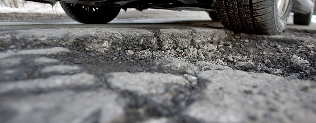 How to avoid pothole damage